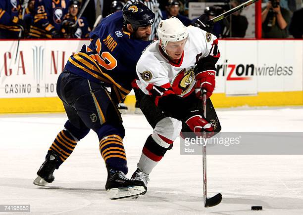 Daniel Alfredsson of the Ottawa Senators tries to get past Adam Mair of the Buffalo Sabres during the third period of Game 5 of the 2007 Eastern...