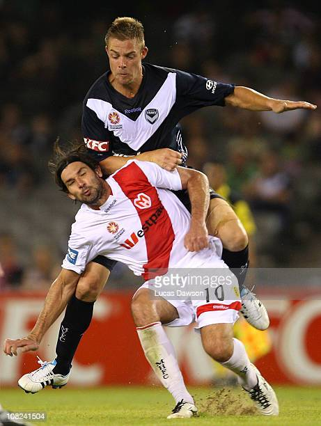 Daniel Allsop of the Victory and Wayne Srhoj of the Heart contest for the ball during the round 24 ALeague match between the Melbourne Victory and...