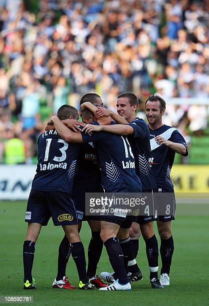 Daniel Allsopp of the Victory is embraced by his teammates following his goal during the round 25 ALeague match between the Melbourne Victory and...