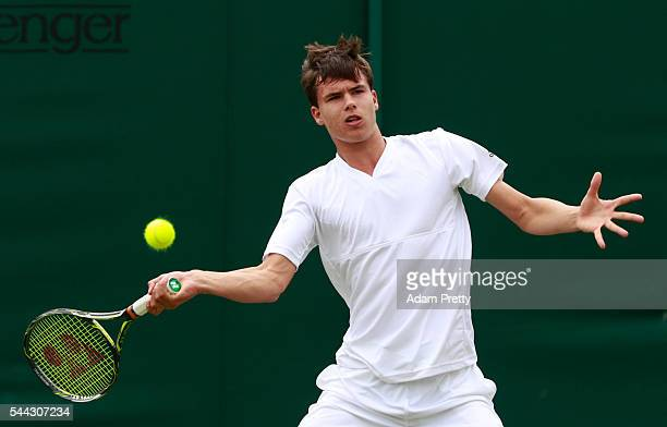 Daniel Altmaier of Germany plays a forehand during the Boy's singles first round match against Max Stweart of Great Britain on Middle Sunday of the...