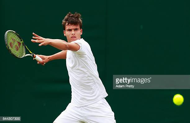 Daniel Altmaier of Germany plays a forehand during the Boy's singles first round match against Max Stewart of Great Britain on Middle Sunday of the...