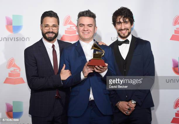 Daniel Alvarez Juan Galeano and Andee Zeta of Diamante Electrico pose in the press room during The 18th Annual Latin Grammy Awards at MGM Grand...