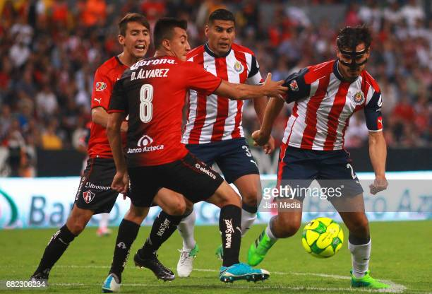 Daniel Alvarez of Atlas and Oswaldo Alanis of Chivas during the final Quarters round match between Atlas and Chivas as part of the Torneo Clausura...