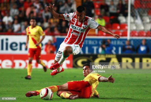 Daniel Alvarez of Necaxa and Miguel Sansores of Morelia during the 17th round match between Morelia and Necaxa as part of the Torneo Apertura 2017...