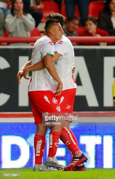 Daniel Alvarez of Necaxa celebrates with teammate after scoring the first goal of his team during the 3rd round match between Necaxa and Atletico San...