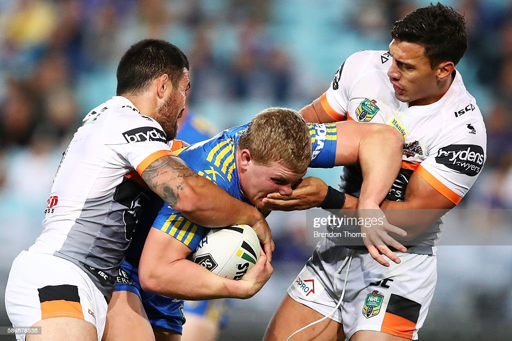 Daniel Alvaro of the Eels is tackled by the Tigers defence during the round 21 NRL match between the Parramatta Eels and the Wests Tigers at ANZ Stadium on July 30, 2016 in Sydney, Australia.