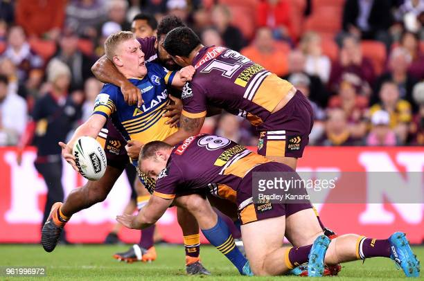 Daniel Alvaro of the Eels offloads during the round 12 NRL match between the Brisbane Broncos and the Parramatta Eels at Suncorp Stadium on May 24...