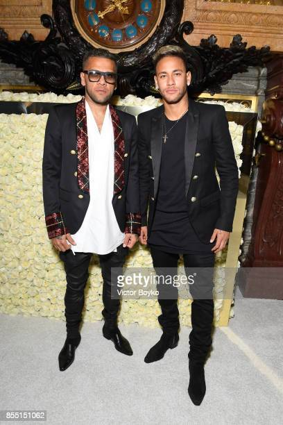 Daniel Alves and Neymar attend the Balmain show as part of the Paris Fashion Week Womenswear Spring/Summer 2018 on September 28 2017 in Paris France