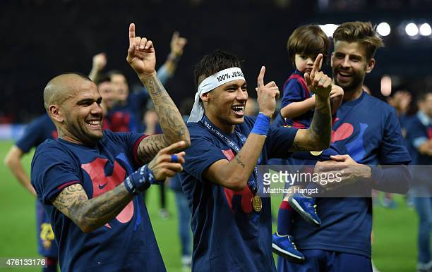 Daniel Alves and Neymar of Barcelona celebrate victory as team mate Gerard Pique looks on during the UEFA Champions League Final between Juventus and...