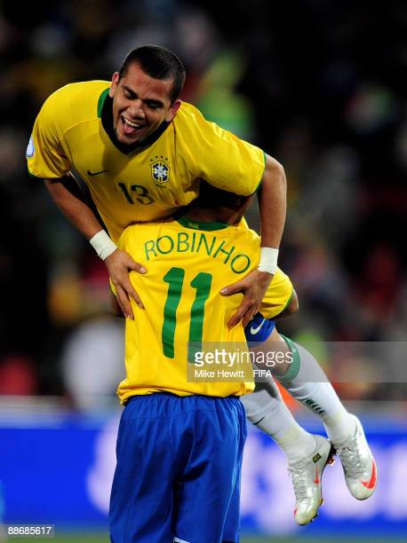 Daniel Alves and Robinho of Brazil celebrate after Brazil's victory over South Africa during the FIFA Confederations Cup Semi Final match beween...