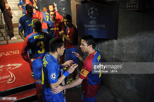Daniel Alves and Xavi Torres of Barcelona speak in the tunnel prior to the UEFA Champions League Semi Final First Leg match between Barcelona and...
