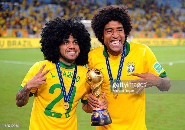 Daniel Alves celebrates with teammate Dante of Brazil at the end of the FIFA Confederations Cup Brazil 2013 Final match between Brazil and Spain at...