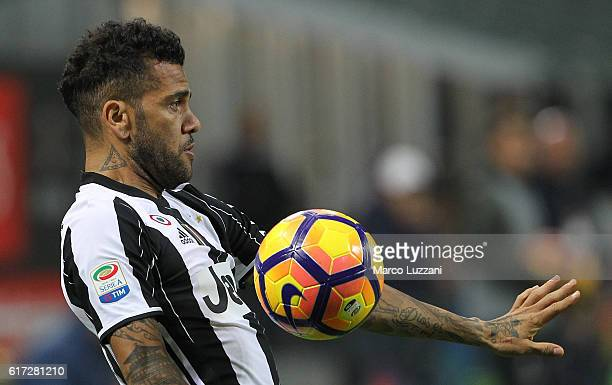 Daniel Alves da Silva of Juventus FC controls the ball during the Serie A match between AC Milan and Juventus FC at Stadio Giuseppe Meazza on October...