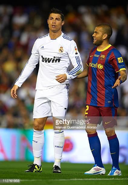 Daniel Alves of Barcelona and Cristiano Ronaldo of Real Madrid talk during the Copa del Rey final match between Real Madrid and Barcelona at Estadio...