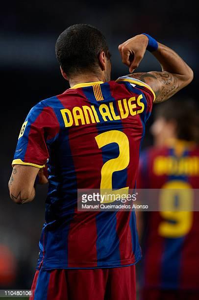 Daniel Alves of Barcelona celebrates after scoring the opening goal during the La Liga match between Barcelona and Getafe at Camp Nou on March 19...