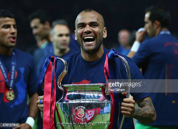 Daniel Alves of Barcelona celebrates with the trophy after the UEFA Champions League Final between Juventus and FC Barcelona at Olympiastadion on...