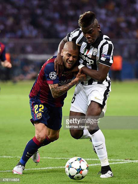 Daniel Alves of Barcelona challenges for the ball with Paul Pogba of Juventus during the UEFA Champions League Final between Juventus and FC...