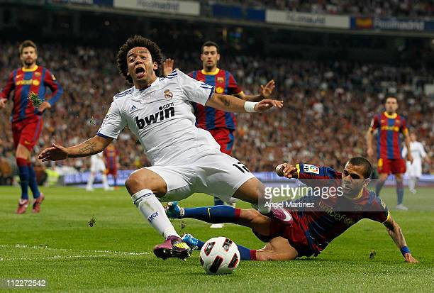 Daniel Alves of Barcelona fouls Marcelo Vieira of Real Madrid in the penalty area during the La Liga match between Real Madrid and Barcelona at...