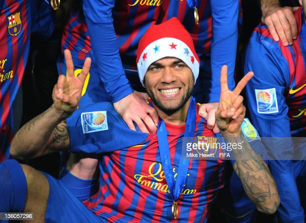 Daniel Alves of Barcelona gets in a festive mood during the victory celebrations after the FIFA Club World Cup Final match between Santos and FC...