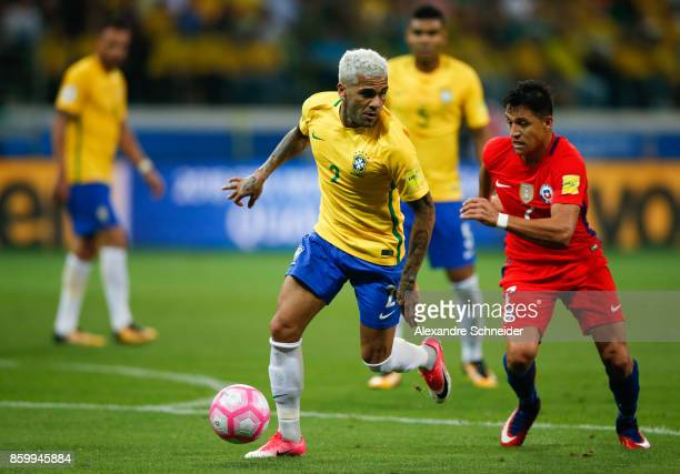 Daniel Alves of Brazil and Alexis Sanches of Chile in action during the match between Brazil and Chile for the 2018 FIFA World Cup Russia Qualifier...