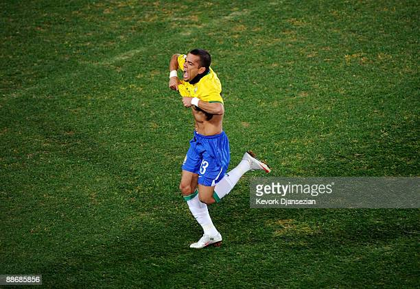 Daniel Alves of Brazil celebrates his goal after scoring on a free kick against South Africa during the FIFA Confederations Cup Semi Final match...