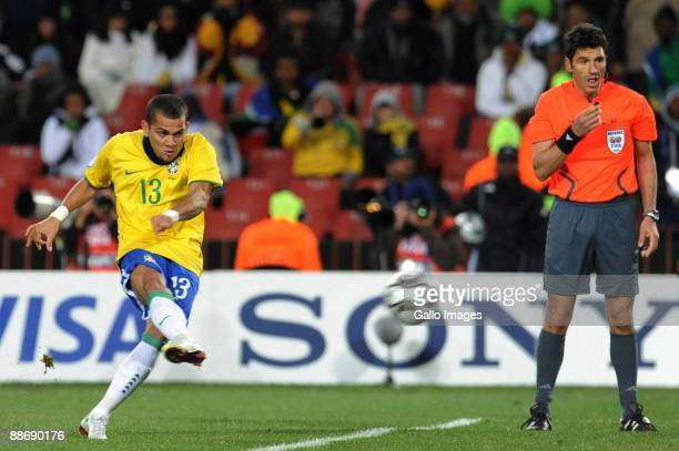Daniel Alves of Brazil scores a free kick with only six minutes to go while referee Massimo Busacca looks on during the 2009 Confederations Cup...