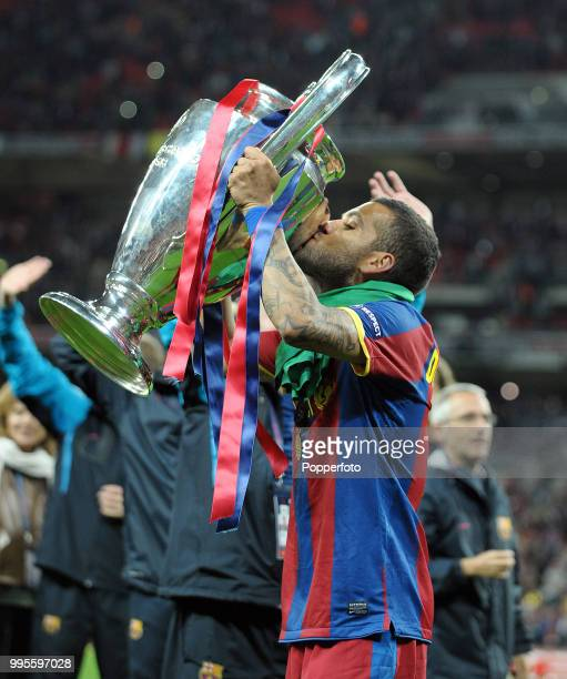 Daniel Alves of FC Barcelona kisses the European Cup following the UEFA Champions League final between FC Barcelona and Manchester United at Wembley...