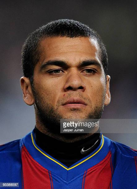 Daniel Alves of FC Barcelona looks on prior to the start of the UEFA Champions League group F match between FC Barcelona and Inter Milan at the Camp...