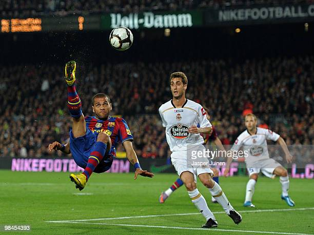 Daniel Alves of FC Barcelona tries to score past Adrian Lopez of Deportivo la Coruna during the La Liga match between Barcelona and Deportivo La...