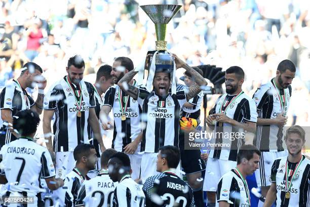 Daniel Alves of Juventus FC celebrates with the trophy after the beating FC Crotone 30 to win the Serie A Championships at the end of the Serie A...