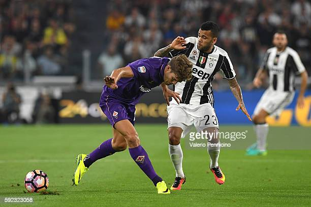 Daniel Alves of Juventus FC competes with Marcos Alonso of ACF Fiorentina during the Serie A match between Juventus FC and ACF Fiorentina at Juventus...