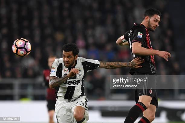 Daniel Alves of Juventus FC competes with Mattia De Sciglio of AC Milan during the Serie A match between Juventus FC and AC Milan at Juventus Stadium...