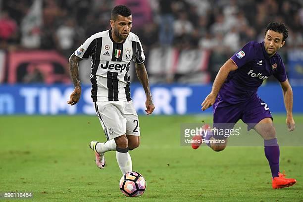 Daniel Alves of Juventus FC in action against Giuseppe Rossi of ACF Fiorentina during the Serie A match between Juventus FC and ACF Fiorentina at...