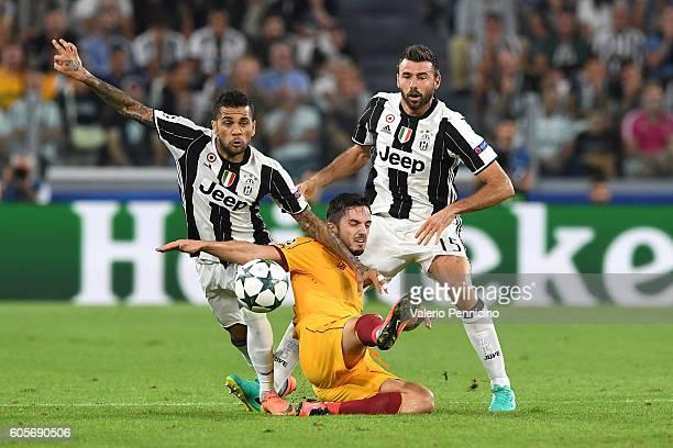 Daniel Alves of Juventus FC tackles Pablo Sarabia of Sevilla FC during the UEFA Champions League Group H match between Juventus FC and Sevilla FC at...