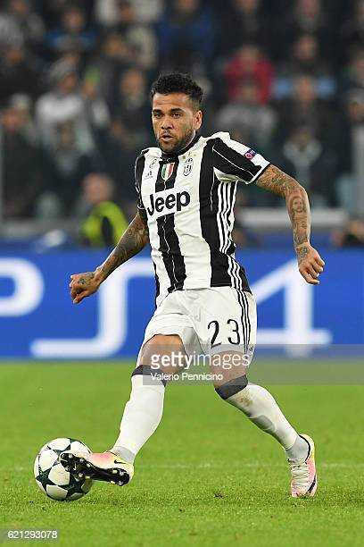 Daniel Alves of Juventus in action during the UEFA Champions League Group H match between Juventus and Olympique Lyonnais at Juventus Stadium on...