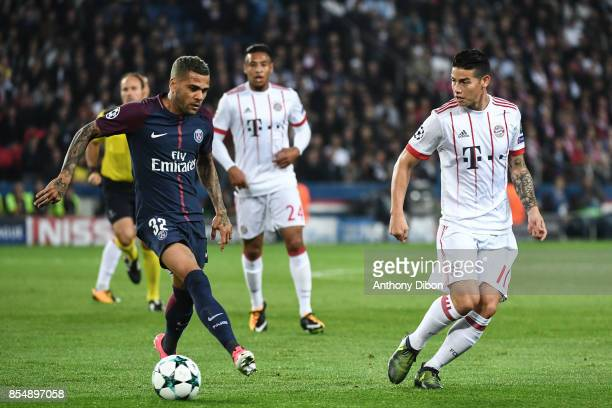 Daniel Alves of PSG and James Rodriguez of Bayern Munich during the Uefa Champions League match between Paris Saint Germain and Fc Bayern Muenchen on...
