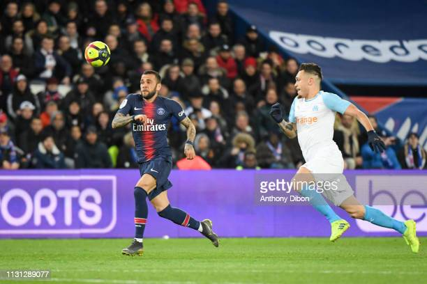 Daniel Alves of PSG and Lucas Ocampos of Marseille during the Ligue 1 match between Paris Saint Germain and Marseille at Parc des Princes on March 17...