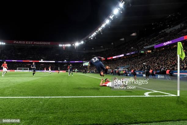 Daniel Alves of PSG is tackle during the Ligue 1 match between Paris Saint Germain PSG and AS Monaco at Parc des Princes on April 15 2018 in Paris