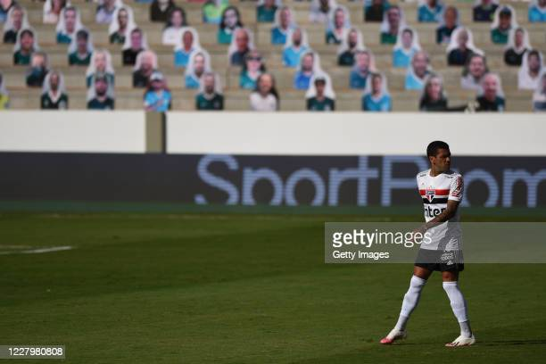 Daniel Alves of Sao Paulo walks before the game between Sao Paulo and Goias as part of the 2020 Brasileirao Series A being postponed and will have to...