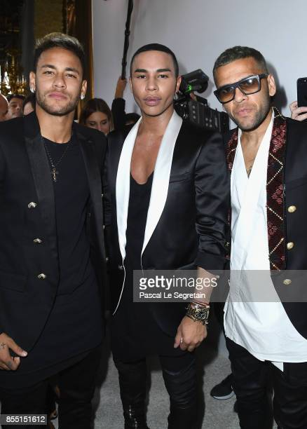 Daniel Alves Olivier Rousteing and Neymar attend the Balmain show as part of the Paris Fashion Week Womenswear Spring/Summer 2018 on September 28...