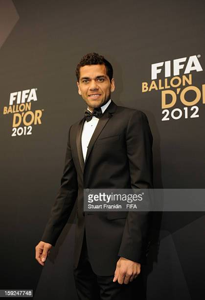 Daniel Alves poses for photographs on the red carpet during the FIFA Ballon d'Or Gala 2012 at the Kongresshaus on January 7 2013 in Zurich Switzerland