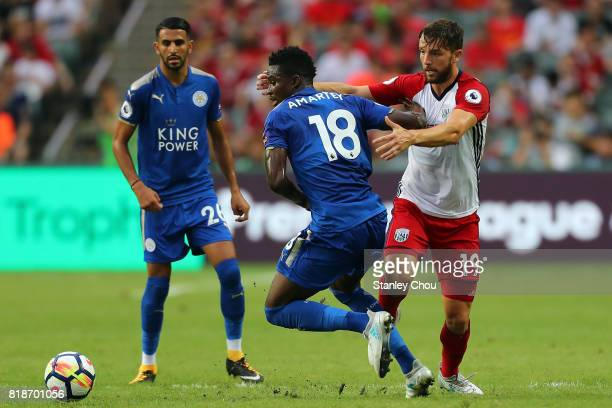 Daniel Amartey of Leiceister City holds off Jay Rodriguez of West Bromwich Albion during the Premier League Asia Trophy match between Leicester City...
