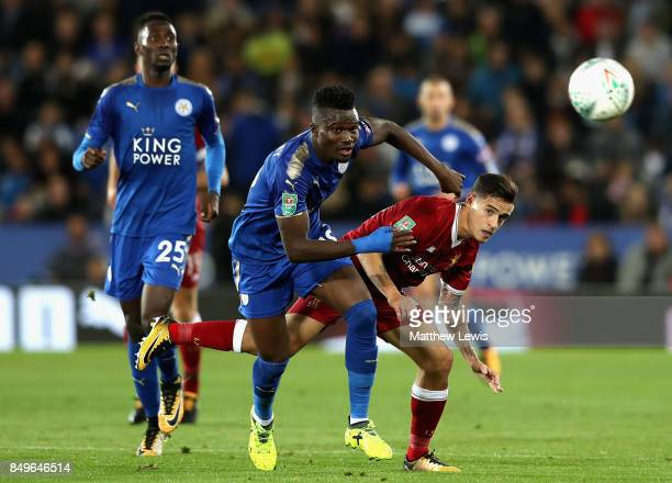Daniel Amartey of Leicester City and Philippe Coutinho of Liverpool battle for possession during the Carabao Cup Third Round match between Leicester...
