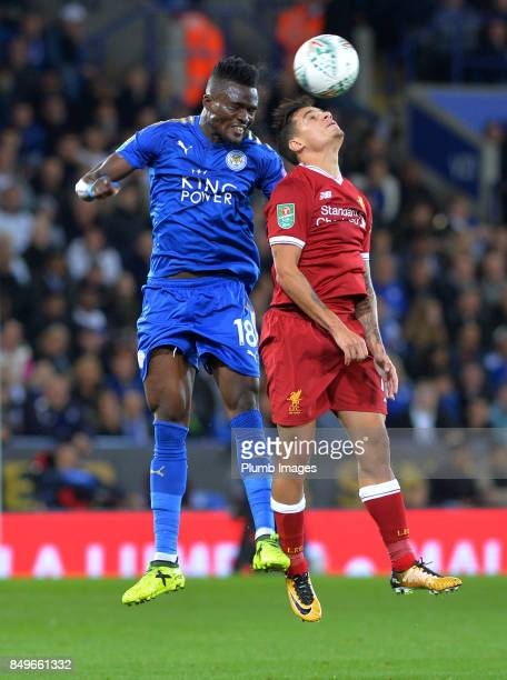 Daniel Amartey of Leicester City and Philippe Coutinho of Liverpool compete for a header during the Carabao Cup third round match between Leicester...