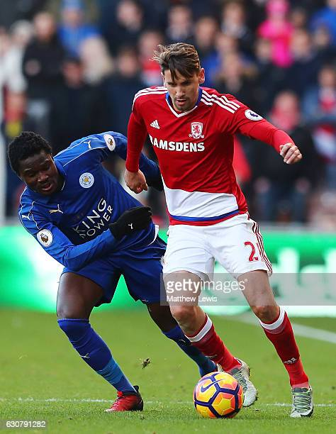 Daniel Amartey of Leicester City attempts to tackle Gaston Ramirez of Middlesbrough during the Premier League match between Middlesbrough and...