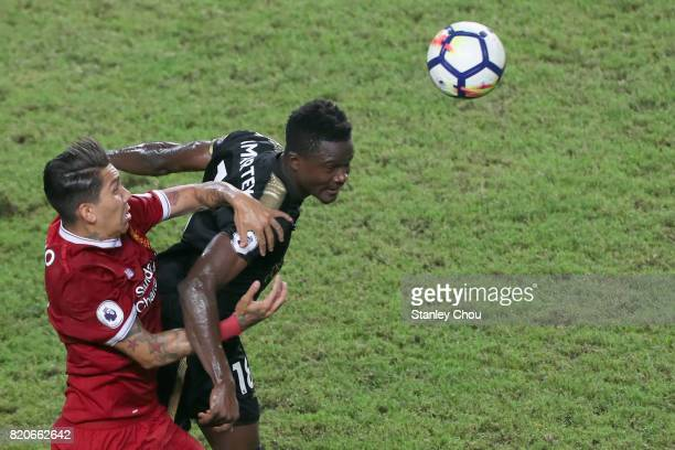 Daniel Amartey of Leicester City battles with Roberto Firmino of Liverpool during the Premier League Asia Trophy match between Liverpool FC and...