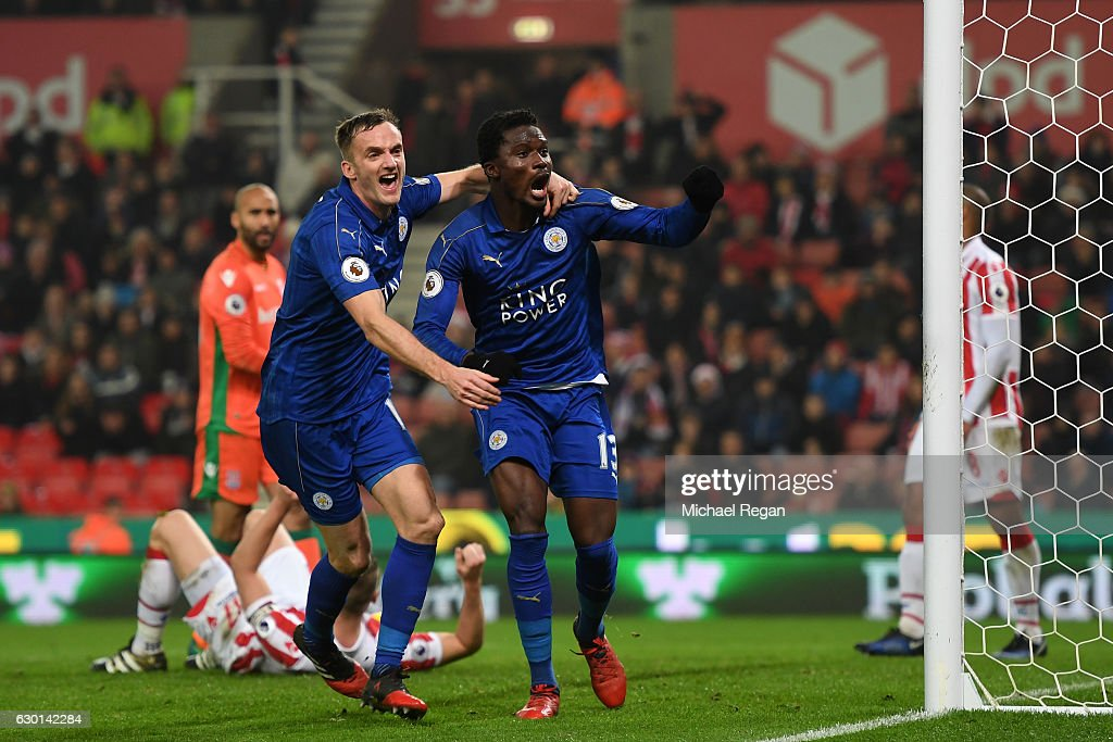 Daniel Amartey of Leicester City (CR) celebrates scoring his sides second goal with Andy King of Leicester City (L) during the Premier League match between Stoke City and Leicester City at Bet365 Stadium on December 17, 2016 in Stoke on Trent, England.