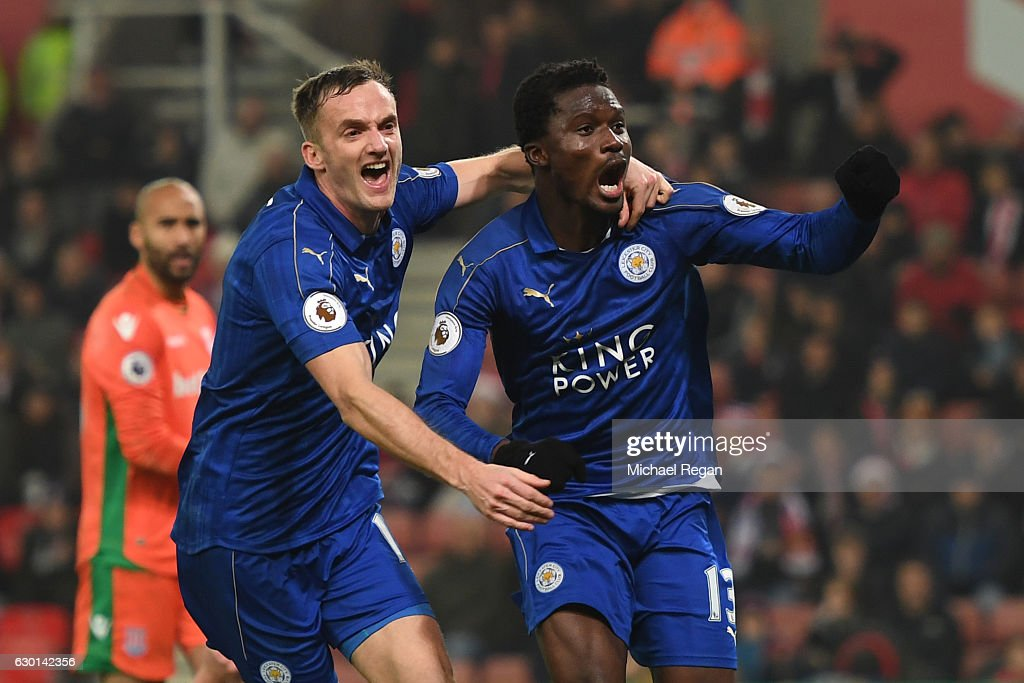Daniel Amartey of Leicester City (R) celebrates scoring his sides second goal with Andy King of Leicester City (L) during the Premier League match between Stoke City and Leicester City at Bet365 Stadium on December 17, 2016 in Stoke on Trent, England.