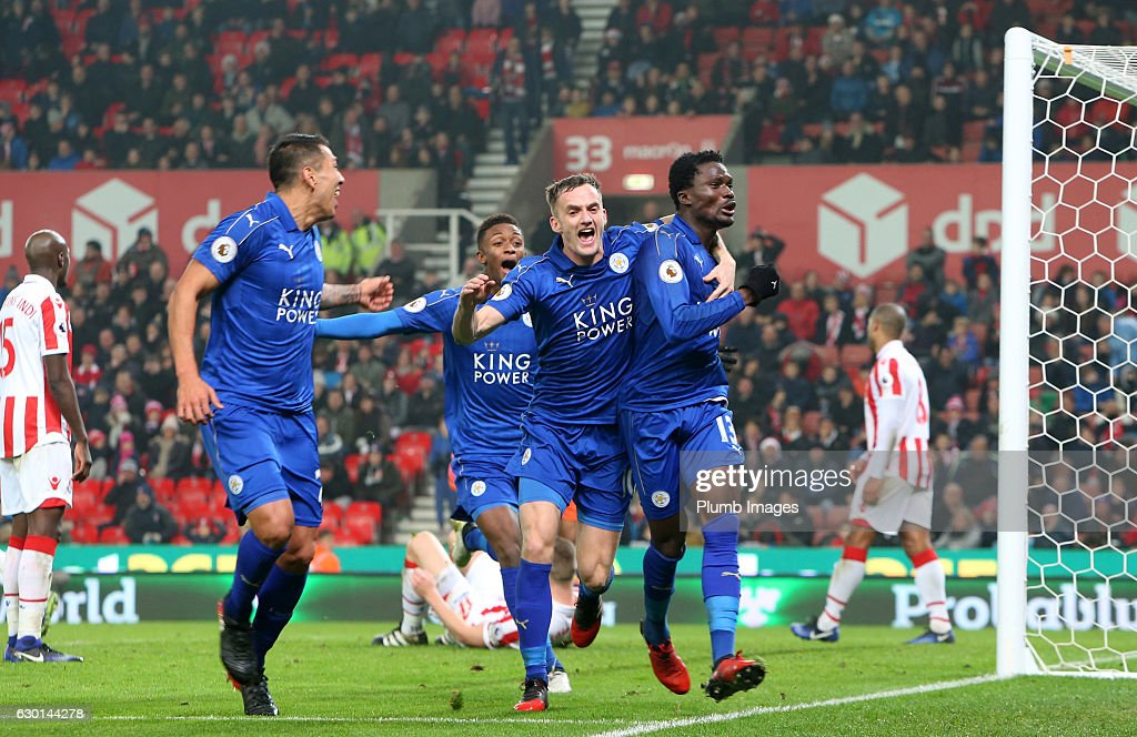 Daniel Amartey of Leicester City celebrates with Andy King and Leonardo Ulloa of Leicester City after scoring to make it 2-2 during the Premier League match between Stoke City and Leicester City at Bet365 Stadium on December 17, 2016 in Stoke, England.