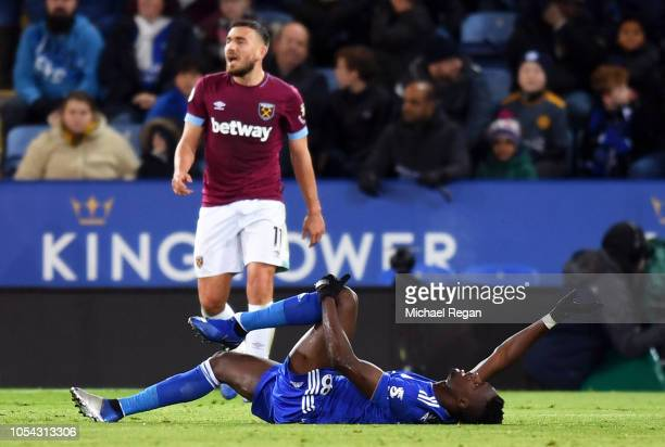 Daniel Amartey of Leicester City goes down injured during the Premier League match between Leicester City and West Ham United at The King Power...